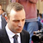 Olympic and Paralympic track star Oscar Pistorius reacts at the end of his trial at the North Gauteng High Court in Pretoria April 10, 2014. REUTERS/Siphiwe Sibeko