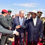 Israeli Prime Minister Benjamin Netanyahu (C) introduces members of his delegation to Uganda's President Yoweri Museveni after arriving to commemorate the 40th anniversary of Operation Entebbe at the Entebbe airport in Uganda, July 4, 2016. Presidential Press Unit/Handout via REUTERS