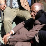 Douglas Mahiya, information secretary of the Zimbabwe National Liberation War Veterans Association (ZNLWVA) is escorted by detectives as he arrives at the Harare Magistrates' court, July 29, 2016.   REUTERS/Philimon Bulawayo