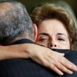 Brazil's former President Dilma Rousseff (R), who was removed by the Brazilian Senate from office earlier, is greeted by former defense minister Aldo Rebelo at the Alvorada Palace in Brasilia, Brazil, August 31, 2016. REUTERS/Bruno Kelly