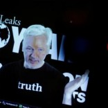 Julian Assange, Founder and Editor-in-Chief of WikiLeaks speaks via video link during a press conference on the occasion of the ten year anniversary celebration of WikiLeaks in Berlin, Germany, October 4, 2016.    REUTERS/Axel Schmidt