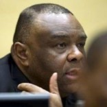 Former Congo vice-president Jean-Pierre Bemba looks up when sitting in the courtroom of the International Criminal Court to stand trial with Aime Kilolo Musamba, Jean-Jacques Mangenda Kabongo, Fidele Babala Wandu and Narcisse Arido, on charges including corrupting witnesses and interfering with the administration of justice in The Hague, Netherlands, September 29, 2015.  REUTERS/Peter Dejong/Pool