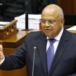 South Africa's Finance Minister Pravin Gordhan delivers his 2014 budget address in Parliament in Cape Town February 26, 2014.   REUTERS/Mike Hutchings