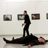 Russian Ambassador to Turkey Andrei Karlov lies on the ground after he was shot by Mevlut Mert Altintas at an art gallery in Ankara, Turkey. Hasim Kilic/Hurriyet via REUTERS