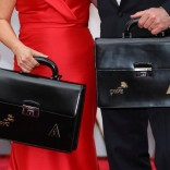 Oscar winning ballots are carried along the red carpet by personnel from Price Waterhouse Coopers as they arrive for the  89th Academy Awards in Hollywood, California, U.S. February 26, 2017. REUTERS/Mike Blake