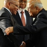 South Africa's new President Jacob Zuma (L) congratulates his new minister of Finance Pravin Gordhan as new Deputy President Kgalema Motlanthe (C) looks on in Pretoria on May 11, 2009. New South African President Jacob Zuma's cabinet appointments show a willingness to compromise to address the country's deep social and economic woes, local newspapers reported.    AFP PHOTO / ALEXANDER JOE / AFP PHOTO / ALEXANDER JOE