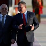 Jordan's King Abdullah II welcomes Iraqi Prime Minister Haider al-Abadi during a reception ceremony at the Queen Alia International Airport in Amman, Jordan March 28, 2017. REUTERS/Muhammad Hamed
