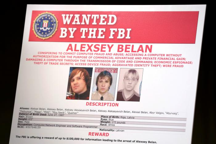 A poster of suspected Russian hackers is seen before FBI National Security Division and the U.S. Attorney's Office for the Northern District of California joint news conference at the Justice Department in Washington, U.S., March 15, 2017. REUTERS/Yuri Gripas