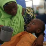 A woman feeds her daughter, who is suffering brain damage resulting from Cerebral Spinal Meningitis, at the Save the Children stabilisation ward in Maiduguri, Nigeria November 30, 2016. Picture taken November 30, 2016. REUTERS/Afolabi Sotunde