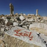 "FILE PHOTO: Graffiti sprayed by Islamic State militants which reads ""We remain"" is seen on a stone at the Temple of Bel in the historic city of Palmyra, in Homs Governorate, Syria April 1, 2016. REUTERS/Omar Sanadik/File Photo"