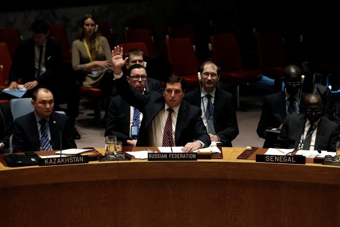 Russian Deputy Ambassador to the United Nations Vladimir Safronkov raises his arm to vote against a United Nations Security Council resolution to ban the supply of helicopters to the Syrian government and to blacklist Syrian military commanders over accusations of toxic gas attacks at U.N. headquarters in New York City, U.S., February 28, 2017. REUTERS/Mike Segar