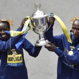 Boston Marathon women's division winner Edna Kiplagat, of Kenya, and men's division winner Geoffrey Kirui, also of Kenya, hold the trophy during the 121st Boston Marathon in Boston, Massachusetts, U.S., April 17, 2017.   REUTERS/Gretchen Ertl