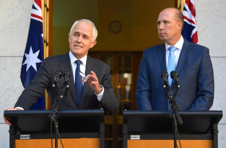Australia's Prime Minister Malcolm Turnbull speaks as Immigration Minister Peter Dutton listens on during a media conference at Parliament House in Canberra, Australia, April 18, 2017.    AAP/Lukas Coch/via REUTERS