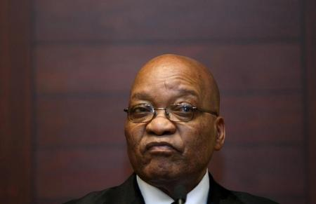 South African President Jacob Zuma listens at a news conference in Cape Town, in this September 10, 2009 file photo. REUTERS/Mike Hutchings/Files - RTX2A6BE