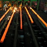 FILE PHOTO: Employees work in a Hangzhou Iron and Steel Group Company workshop in Hangzhou, Zhejiang province August 4, 2009. REUTERS/Steven Shi/File Photo