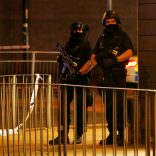 FILE PHOTO: Armed police officers stand next to a police cordon outside the Manchester Arena, where U.S. singer Ariana Grande had been performing, in Manchester, northern England, Britain, May 23, 2017. REUTERS/Andrew Yates/File Photo