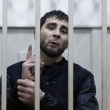 FILE PHOTO: Zaur Dadayev, charged with involvement in the murder of Russian opposition figure Boris Nemtsov, speaks inside a defendants' cage in Moscow, Russia March 8, 2015. REUTERS/Tatyana Makeyeva/File Photo