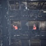 Members of the emergency services work inside the charred remains of the Grenfell apartment tower block in North Kensington, London, Britain, June 17, 2017. REUTERS/Hannah McKay