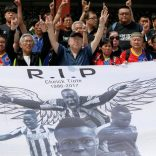 Supporters react behind a banner with image of soccer player Cheick Tiote, former Ivory Coast international who died in hospital last week after collapsing during a training session for his Chinese club Beijing Enterprises, during a memorial service in Beijing, China June 13, 2017. REUTERS/Damir Sagolj