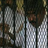 FILE PHOTO: Hesham Talaat Moustafa, former chairman of the Talaat Moustafa Group, stands inside a cage at a court in Cairo, Egypt June 25, 2009.  REUTERS/Asmaa Waguih/File Photo