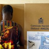 FILE PHOTO: A man casts his vote at a polling station during the 2012 national elections in Luanda, Angola,  August 31, 2012. Picture taken August 31, 2012. REUTERS/Siphiwe Sibeko/File Photo