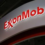 A logo sits illuminated outside the Exxon Mobil Corp. corporate pavilion during the 21st World Petroleum Congress in Moscow, Russia, on Monday, June 16, 2014. Work between Texas-based Exxon, the world's largest oil company by market value, and state-run Rosneft on Sakhalin Island in Russias Far East provides a template for further exploration, especially in the Arctic's Kara Sea, Exxon Mobil Corp. Chief Executive Officer Rex Tillerson said at the World Petroleum Congress in Moscow today. Photographer: Andrey Rudakov/Bloomberg via Getty Images