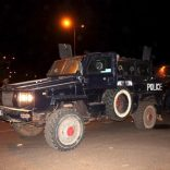 Malian police stand guard in an armored vehicle near the site of an attack on a hotel in Bamako that had been converted into the headquarters of a European Union military training operation, March 21, 2016. REUTERS/Adama Diarra