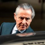 FILE PHOTO: Miguel Blesa, former chairman of savings bank Caja Madrid, leaves the High Court in Madrid, Spain March 3, 2014. REUTERS/Sergio Perez/File photo