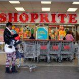 A shopper is seen outside a Shoprite store in Johannesburg July 7, 2015.  REUTERS/Siphiwe Sibeko/File Photo - RTX2MO0A