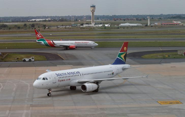 FILE PHOTO: A South African Airways aircraft (bottom) arrives as a Kenya Airways aircraft prepares to take off at the OR Tambo International Airport in Johannesburg, South Africa, March 8, 2017. REUTERS/Siphiwe Sibeko/File Photo