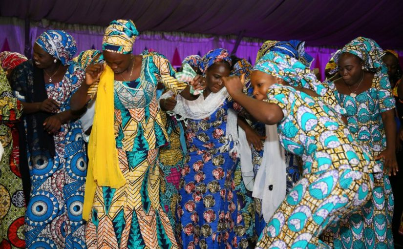 Some of the 106 girls who were kidnapped by Boko Haram militants in the Nigerian town of Chibok are seen dancing during the the send-forth dinner organised for them in Abuja, Nigeria September 13, 2017. REUTERS/Afolabi Sotunde